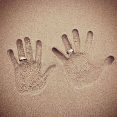 wedding photo~ handprints in the sand