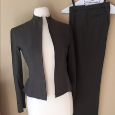 """Guess two Piece Pants Suit Very nice pants suit from Guess Collection. Color is gray/dark green. Has been in dry cleaner bag since last cleaning. NOTE - jacket zipper is functional but can stick at bottom. Fabric is 53poly/43wool/4spandex. Jacket lined. Pants have small pleat in front, front zipper, and waist with two button adjustment. Length from waist to hemline is 37"""" with 3"""" hem if more length needed. Check out $6 section near bottom closet (before sold items) for bundle-worthy $6…"""