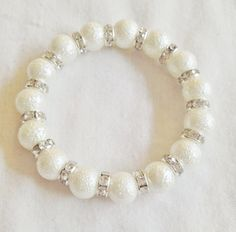 Moon pearl sparkly bracelet by Hellenna on Etsy, £8.00