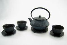 iron tea pot and cups