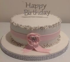 Bling cake, with silver and white balls and pink fondant ribbon.