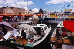 Selling fruit and vegetables from boats, kauppatori (fish market) on the harbour. - Helsinki, Finland Read more: Places To Travel, Travel Destinations, Places To Go, Geography For Kids, Helsinki, Lonely Planet, Homeland, Teaching Kids, Reindeer