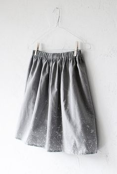 Best idea EVER - splatter painting grey fabric with white paint. Maybe even splatter bleaching?