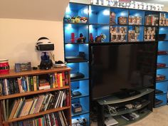 Video game shelf. Video game room. Video game console cabinet with LED lights. XBox Playstation Nintendo VR collection