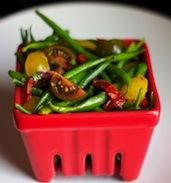 A refreshing and simple tomato and haricots verts salad gets a dose of tangy, sweet balsamic vinegar. Mix in blanched butterbeans for yet another colorful addition.