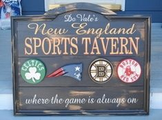 New England Sports Tavern sign, sports logos in larger size celtics red sox patriots bruins