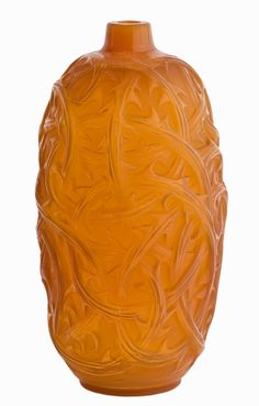 A RENE LALIQUE 'RONCES' VASE, CIRCA 1930  the ovoid amber glass body moulded with a continuous frieze of entwined briar  moulded mark R. Lalique, France  23cm high