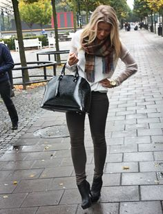 Create a similar look. Green cargo pants, white long sleeve, scarf, and booties.