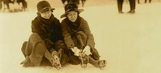 Two Ice Skaters c. 1919 Closeup shot of two girl ice skaters lacing up their old leather skates in Washington DC.