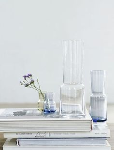 Carafes and Single Stem Flowers. Styling.