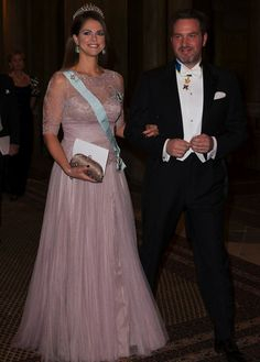 At the Royal Palace of Stockholm, the King Carl Gustaf, Queen Silvia, Crown Princess Victoria, Prince Daniel, Prince Carl Philip and his fiancée Sofia, Princess Madeleine and Christopher O'Neill, Princess Christina and her husband presided a gala dinner in honor of the Nobel Prize 2014.