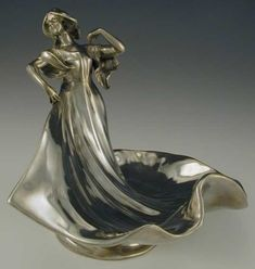 Polished pewter art nouveau figurine based on the well known dancer Louie Fuller, Germany, 1905