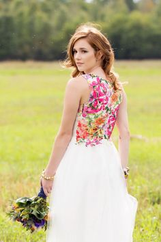 This wedding dress is traditional in the front, so you can be bold in the back.
