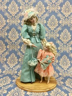 Gibson Girl: Mother's pride and joy. Franklin Mint porcelain dolls set.