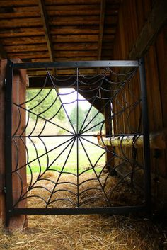 Jane's gate/ Jane is a cow, and this is a gorgeous handmade spider web gate!