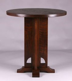 """Extremely rare Limbert cutout cafe table #318.  Unsigned except marked """"318"""" underneath top.  Also signed with retailers paper label """"Bailey's Tables"""".  Refinished.  29.5″h x 28″d"""
