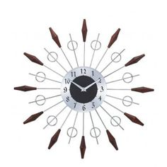 This piece I think both the Mr. and the Mrs. could agree on--the masculinity of the metal and wood is balanced by the more feminine shapes, making a beautiful, balanced, oh-so-chic clock!