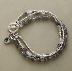 """STORM CLOUDS BRACELET--Storm cloud colors of labradorite, moonstone and amethyst are shot through with the radiance of sterling silver beads. Toggle clasp. Exclusive. Handcrafted in USA. Approx. 7-1/2""""L."""