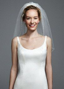 """This elbow length veil, features 1 tier with an embellished edge. The embellishment used on the edge features pearls, beads and sequins, this is sure to make any bride sparkle on her special day. Measures approx. 30""""L x 60""""W. Imported. A shorter veil, often in multiple layers, extending to the elbow.Small, shiny iridescent discs sewn on fabric to add sparkle."""
