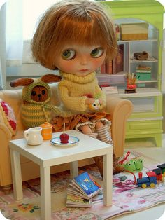 Emelie on my sewing table.  Can you see what is in her focus?