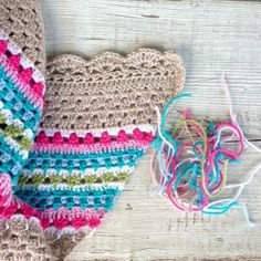 I like the neutral color with the brights and all the different stitches!