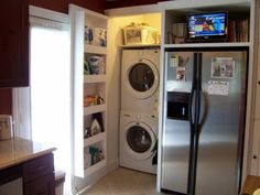 Washer/Dryer in a closet with a shelf on the back of the door for storage