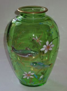 From lionsgate, Very nice Bohemian art glass vase in brilliant green glass with applied fish swimming amonst colorful enamel decoration.