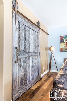 This big two-panel barn door we built/installed for a customer features our 8″ hardware set and reclaimed rope handle. The door is made from our Tobacco Barn Grey materials.