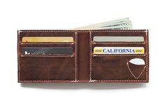 4 slots for cardsCompartment for billsPocket for guitar pickLined in pigskin100% full grain leather