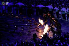 66 The final torchbearers light the Olympic Cauldron during the opening ceremony of the London 2012 Olympic Games at the Olympic Stadium . DAVID GRAY/REUTERS