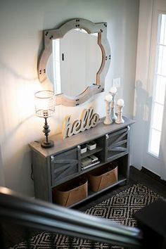 Say hello! First impression rusting traditional charm in this foyer front entry! Geometric rug and gray wash custom furniture and rod iron lamp as well as white wash candle sticks for added rustic farmhouse charm! Grey Wood Furniture, Custom Furniture, Entryway Cabinet, Huge Mirror, Interior Styling, Interior Design, Indoor String Lights, Iron Decor, Geometric Rug