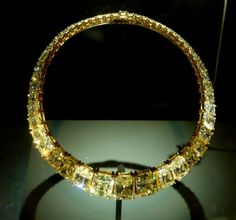 The Cartier Hooker Necklace -   This suite of jewelry was designed by Cartier in the late 1980s. The necklace has 50 starburst-cut fancy yellow diamonds set in yellow gold that range in size from 1.0-20 carats and total approximately 245 carats. (Smithsonian)