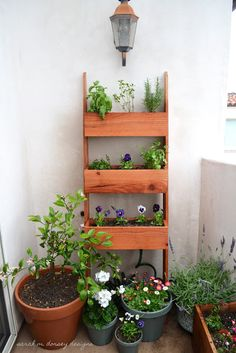 A planter made from redwood fence posts, designed with a slight lean into the wall. This might be my favorite.