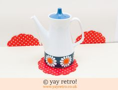 Turi Design Daisy Coffee Pot - Buy yay retro Handmade Crochet online - Arts & Crafts Shop, crochet shawls, wraps, blankets, hot water bottle covers and vintage textile cushions. Craft Shop, Vintage Textiles, Crochet Shawl, Large White, Blue Backgrounds, Tea Pots, Daisy, Wraps, Arts And Crafts