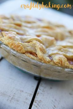 Crispy crust filled with sweet homemade peach pie filling and finished with a lattice top!  - Craftily Baking
