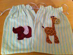 Bosses de tela per roba nadó amb dibuix d'animal aplicat