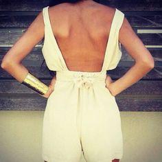 love the color and back of this romper