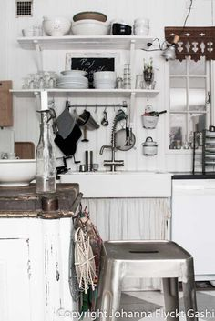 Rustic, white, farmhouse kitchen with oodles of quirky vintage details.
