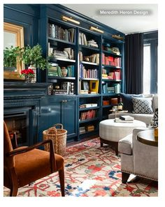 """Designer says color is Benjamin Moore Lead  Gray but looks nothing like the paint chip, comes out indigo blue. She used """"high gloss"""" lacquer on this bookshelf wall, then wrapped the remaining three walls in same color but in an eggshell finish. Says the room is long and narrow and using the one bold color all the way around makes the room look twice as large. This room is used for media viewing and entertaining, and that the bold deep color provides great backdrop for that."""