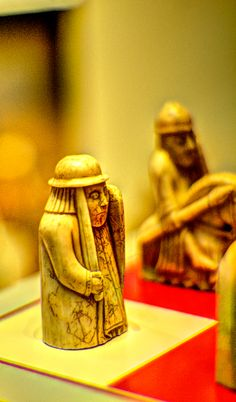 Lewis chessmen - a rook & a knight - part of the 67 piece collection, made from walrus ivory & whale's teeth. Carved in the 12 century, they're one of the British Museum's outstanding 'treasures'. Often missed, they're on the first level, past the window looking onto the Great Court, twenty paces ahead of you.