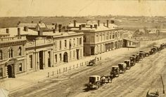 King William Street, Adelaide, 1870 - This is the west side, with North Terrace in the distance. The original ES&A bank premises and the Bank of Adelaide can be seen. The building with a verandah is the original Gresham Hotel. Horse cabs for hire line the centre of the road. Gresham place is shown. Adelaide South Australia, Victoria Australia, Local History, Modern History, Family History, City Of Adelaide, Australian Photography, Williams Street, Australia