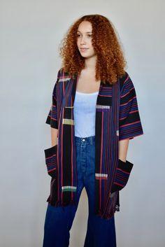 Modern kimono jacket with vintage African textiles. By Mira Blackman #handwoven #slowfashion #casualstyle #ethicalfashion #bohostyle #boholux #black #red #blue #stripes