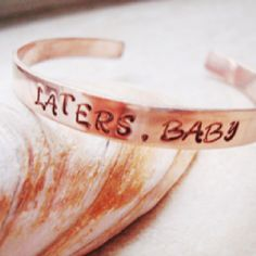 http://www.etsy.com/listing/97273807/laters-baby-handstamped-copper-cuff