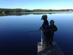 Boys fishing in summer cottage