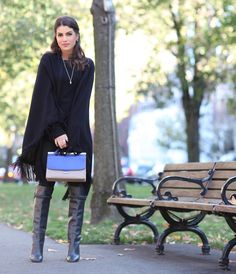 all black winter look with poncho and boots camila coelho