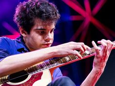 TED Talk:   Usman Riaz is a 21-year-old whiz at the percussive guitar, a style he learned to play by watching his heroes on YouTube. The TED Fellow plays onstage at TEDGlobal 2012 -- followed by a jawdropping solo from the master of percussive guitar, Preston Reed. And watch these two guitarists take on a very spur-of-the-moment improv