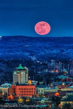 The City lights over Traverse City Michigan with the Pink Full Moon. Watermark Photography.  Beautiful