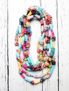 A real statement necklace made of scraps of paper and fabric.
