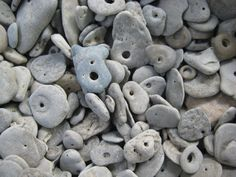 "Lucky Stones: stones with naturally occurring holes found on the beaches of Lake Winnipeg around Gimli, Manitoba, Canada. The majority of these are imprints and ""negatives"" of gastropods or snails. Rocks And Gems, Rocks And Minerals, Lake Winnipeg, Hag Stones, Rock Hunting, Lucky Stone, Native American Artifacts, Canada Travel, Nature"