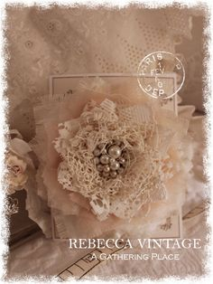 Tattered Pins made from old laces, trims, rhinestones and baubles...  From A Gathering Place - REBECCA VINTAGE